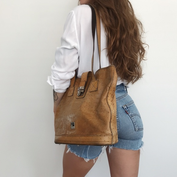 Dooney & Bourke Handbags - •Authentic Dooney & Bourke• Ostrich purse